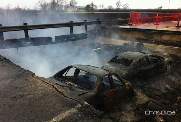 Burnt-out vehicles sit in a pit after the bridge leading into Vita, Manitoba collapsed amid fire on Tuesday, October 2, 2012. (STAN MILOSEVIC / CHRISD.CA)