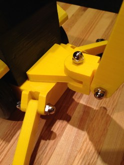 Backhoe pivot bracket