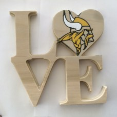 After painting the Vikings logo outline black and sanding the excess paint off.