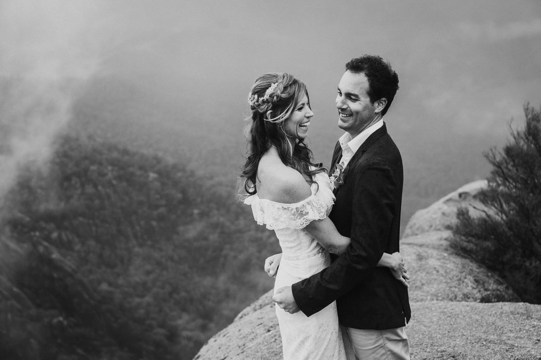Mt Beauty wedding photographer photographing bride and groom on a cliff top