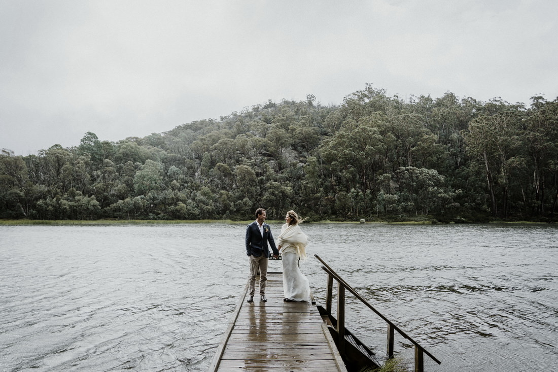 Bride and groom standing on a pier at Mount Buffalo