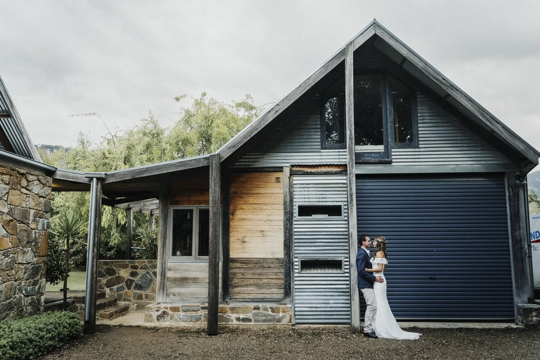 Portrait of a bride and groom standing in front of The House at Smoko by Wodonga wedding photographer