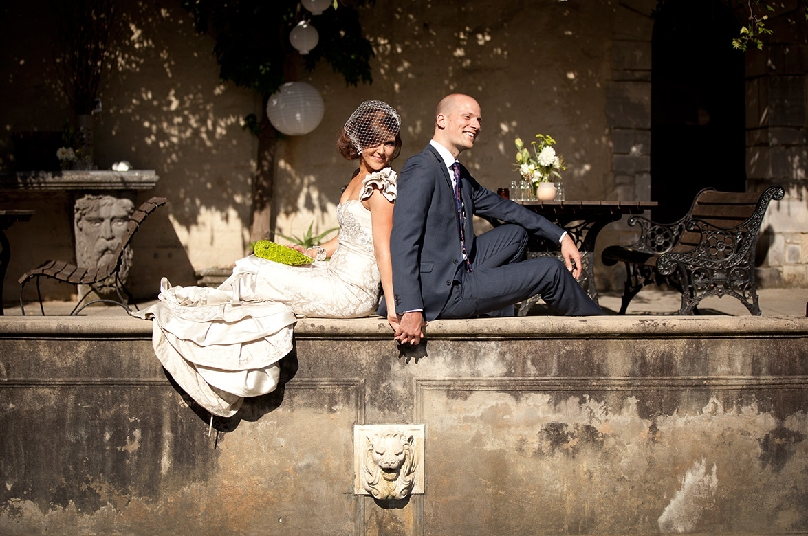 Melbourne Wedding Photographer at Montsalvat with bride and groom sitting next to the pool