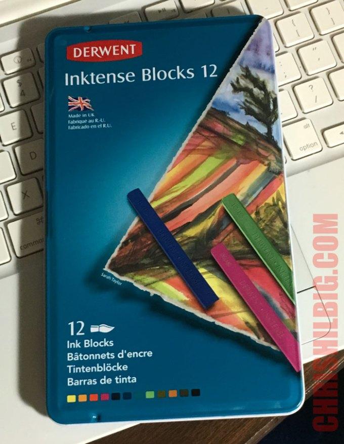 A photo of a tin of Derwent Inktense Blocks closed.