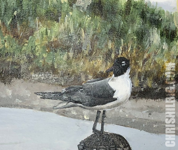 A close-up of my seagull painting demonstrating how the light reflect right off the dried surface when taking a photograph.