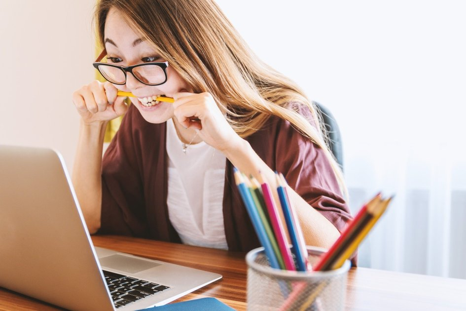 Woman biting pencil