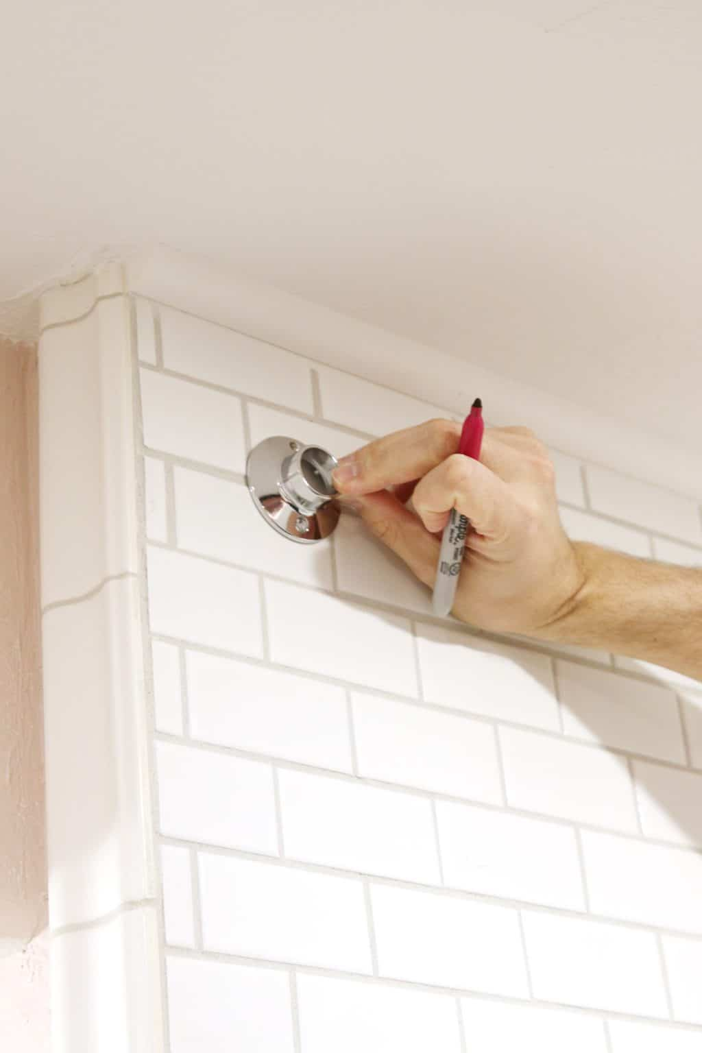 how to drill into tile to hang a shower