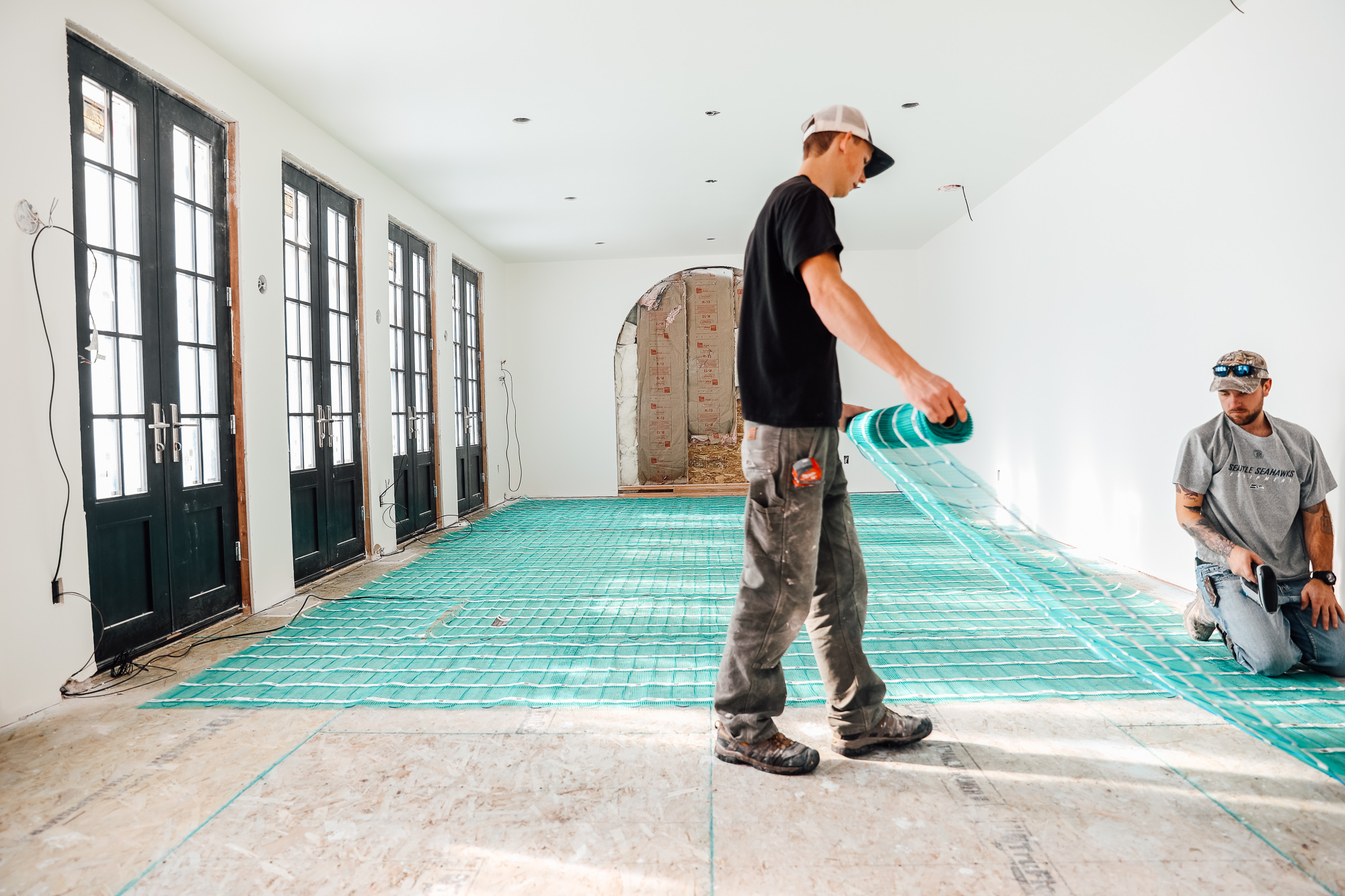 laying heated flooring under tile