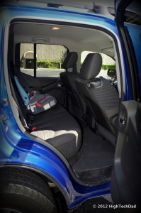car seat placed in the back seat of a car