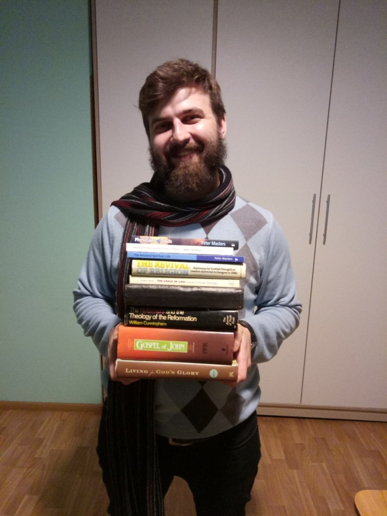 Man holding books of theology