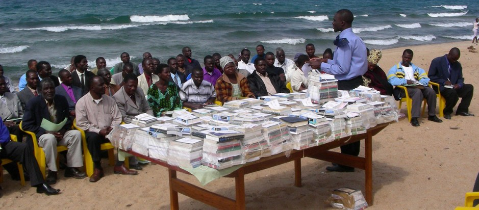 books distributed on a beach