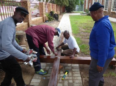 Attaching the Cross beam, adding nuts and bolts and staining the Cross