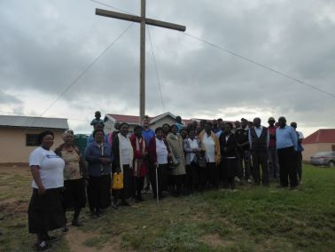 Congregation gathers around the Cross