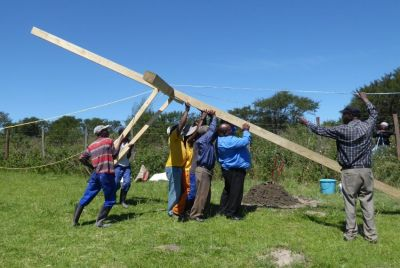 Pastor Malindi joins in and leads the lifting team