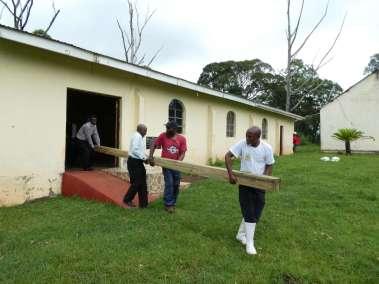 Removing main Cross beam form church