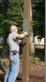 Bob attaching plaque