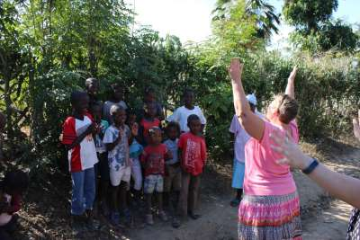 Mary Harris Haiti Missionary led the Team. Here Praising The Lord for the Cross