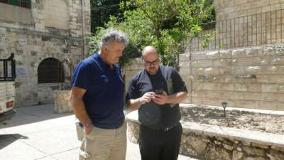 Pastor BIll And Father Jamil Check GPS Coordinates