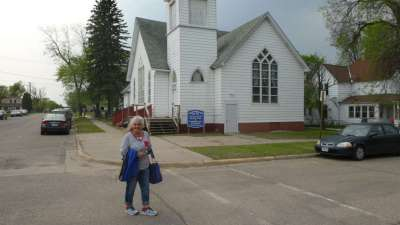 Pastor Carol infront Of Donated Church