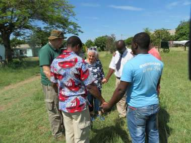 Pastor Carol leading the Cross planting team in Prayer.