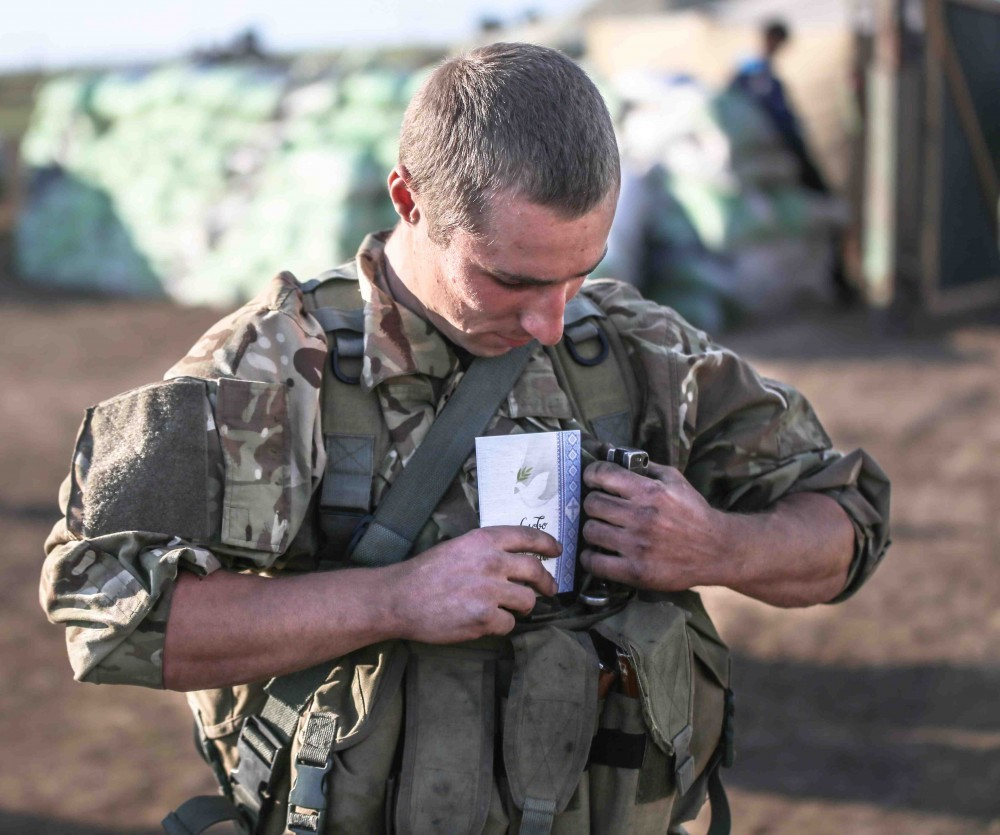 A Ukrainian soldier carries his copy of the Gospel of John, in his tactical vest, over his heart. Photo courtesy of The Gideons International in Canada