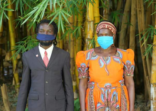 Zebron Mwale (left) and Mary Mweemba stand side by side in April 2021. They are both farmers and neighbors who live in Popota, southern Zambia.