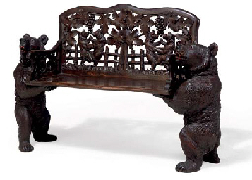 A Swiss Black Forest Carved Linden Wood Bench By Ed