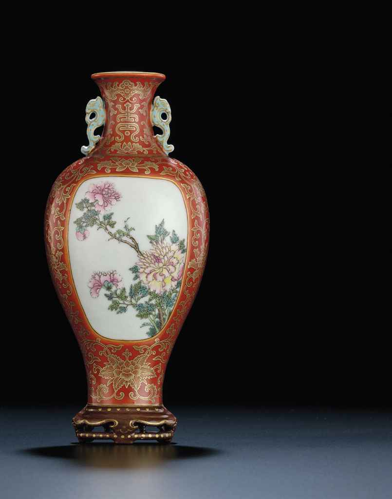 A FINELY PAINTED IRON-RED GROUND FAMILLE ROSE WALL VASE ... on Iron Wall Vases id=20621