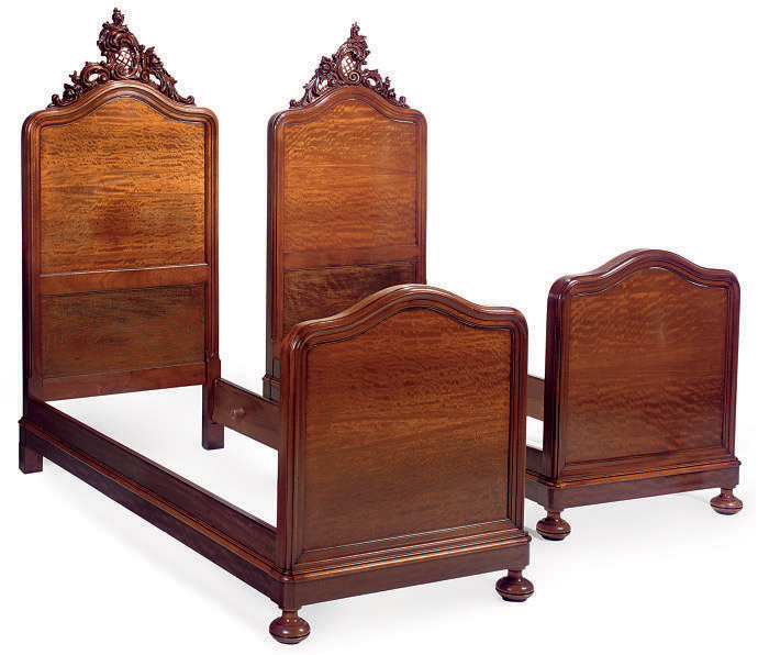 a pair of french mahogany twin beds
