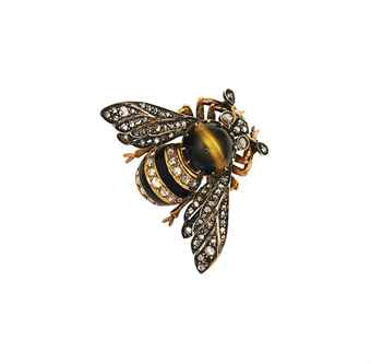 A late 19th century tiger's eye quartz, diamond and onyx bee brooch