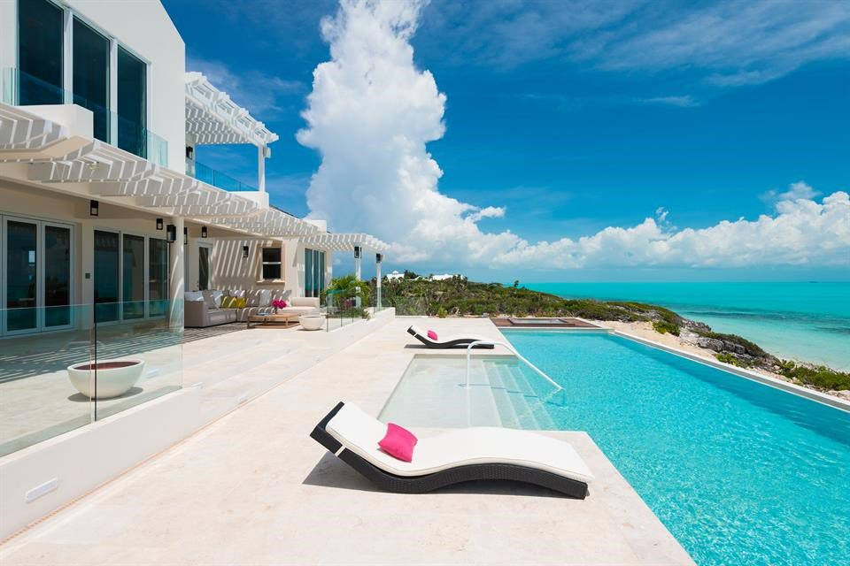 6 Bedrooms,  5,960 sq. ft.Live a life of spectacular luxury within this magnificently constructed estate on Long Bay Beach, Providenciales. Villa Isla is built on one of the higher beach dunes and comprises five beachfront bedrooms, six bathrooms, and 5,960 sq. ft. of living space. Built to very high specifications by one of the island's renowned builders, this villa boasts grand architectural features and fine finishes throughout.