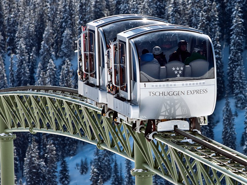 Enjoy beautiful views over the wintry Alpine landscape as the Tschuggen Express climbs the 492 feet to the main skiing area of Arosa