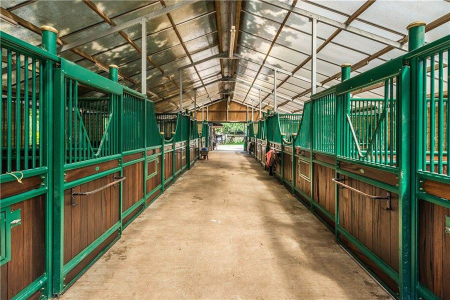 Dating from the 17th century, June Farm in Surrey is the quintessential English country estate complete with gardens and paddocks as well as a barn and sand arena.