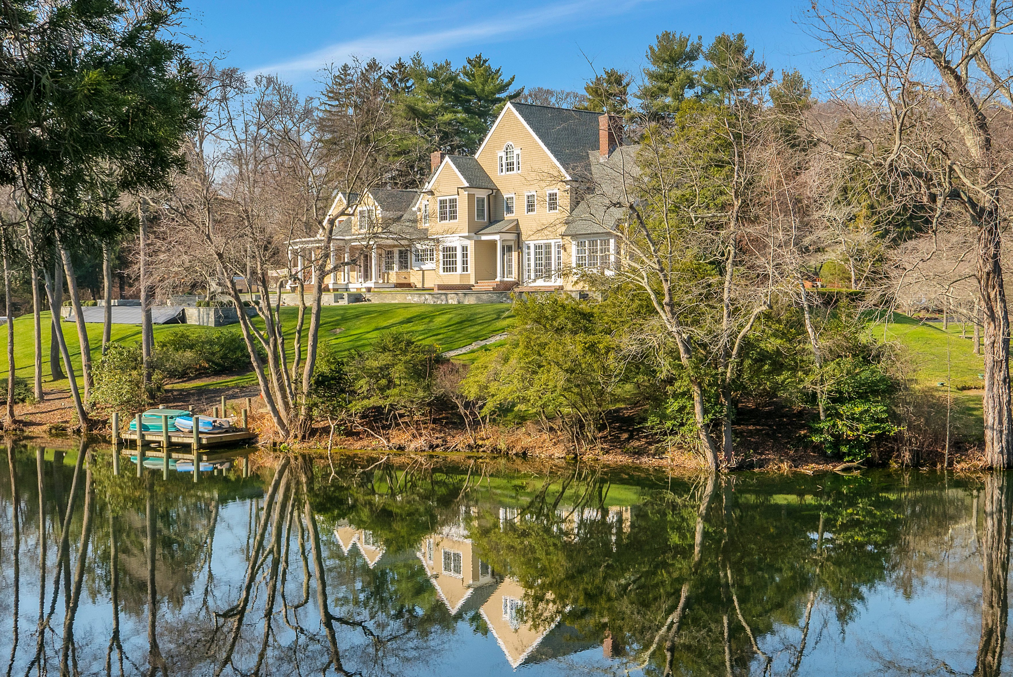 6 Bedrooms, 5,844 sq. ft.Custom estate with pond and stone wine cellar