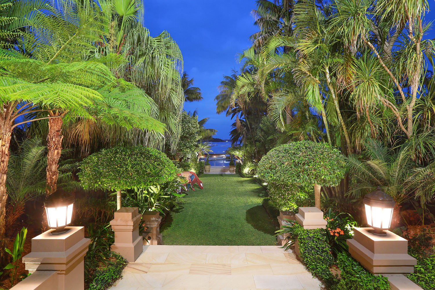 Twilight at Berthong serves to accentuates its lush, tropical landscape design.