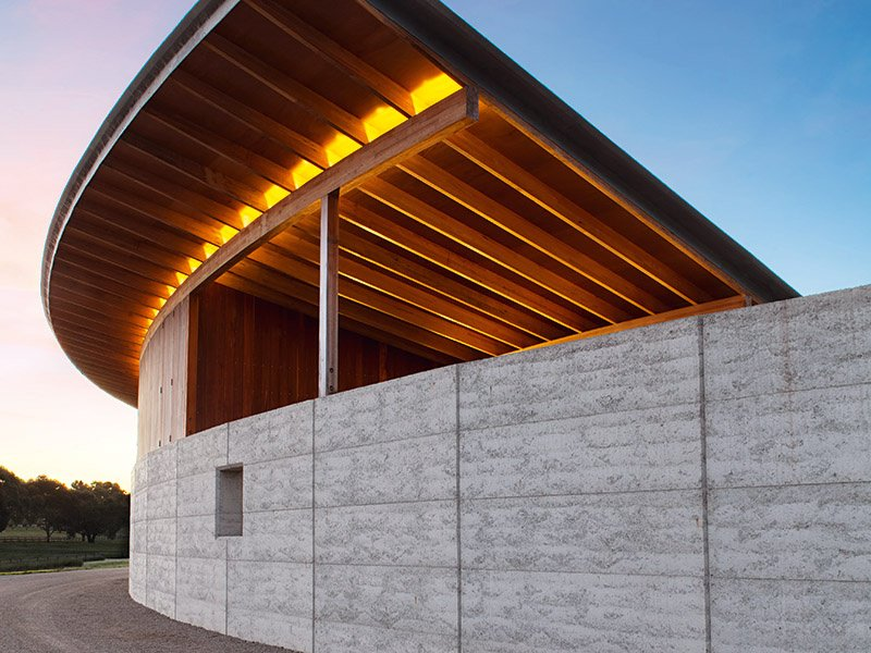 Merricks's stables are framed by a reinforced wall of rammed earth, which offers shelter from weather elements. Photograph: Lisbeth Grosmann