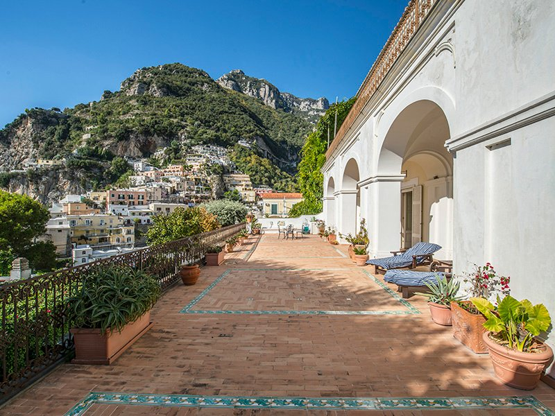 This two-bedroom apartment in Positano is a short walk from the beach, and comes complete with a 108-square-foot (10 sq m) garage that could be enlarged.