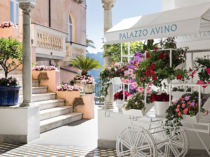 Palazzo Avino, a 12th-century villa that is now a five-star hotel, is known for its pink stucco façade and flower-filled terraces.