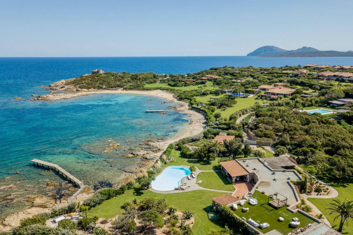 This exclusive waterfront villa is exquisitely located in a rare, sought-after location on Sardinia's Costa Smeralda. The property includes a pool, gym, and spa, beautiful gardens, a private dock, and direct beach access.