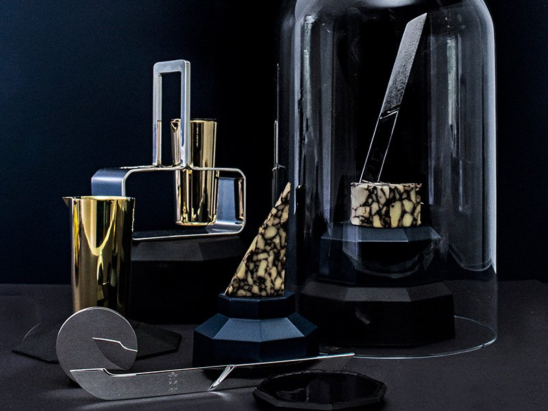 Christopher Jenner and E&Co's cheese knife and cruet set from the Epicurean Collection. The collection also features a silver butter dish with crystal lid, the Ritual teapot, and the Trophy ice bucket, which is big enough to hold two bottles of champagne or a magnum.