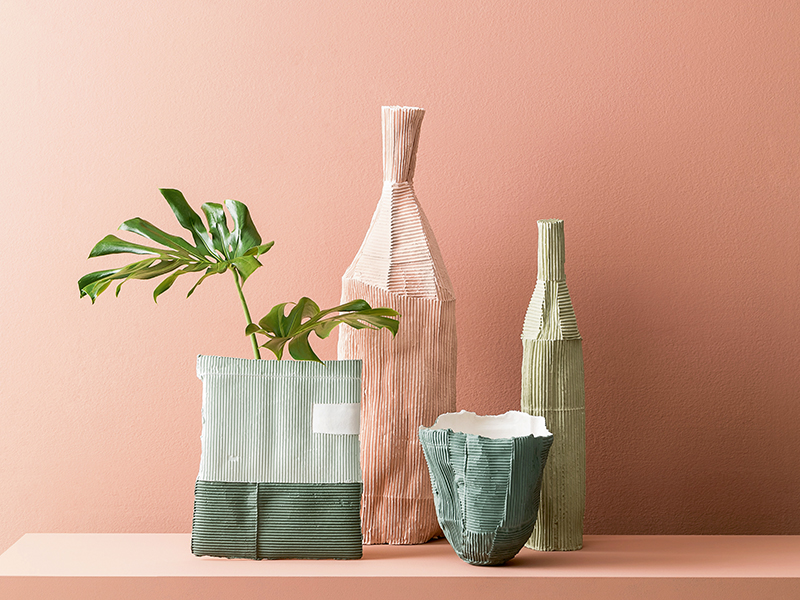 Pink and green bottles and vases in pink room