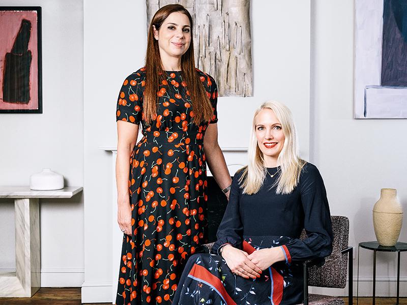Two women smiling