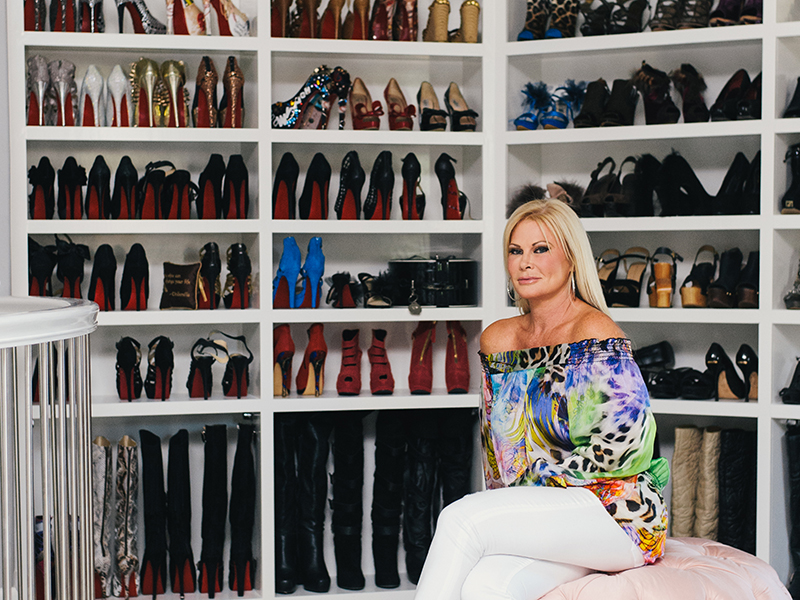 Theresa Roemer in front of her shoe collection
