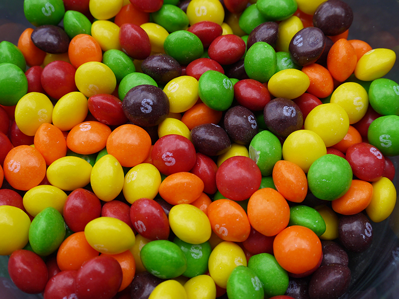 A bowl filled with skittles