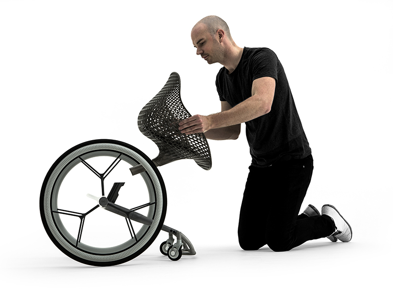 Benjamin Hubert pictured assembling one of his futuristic designs, the Go wheelchair