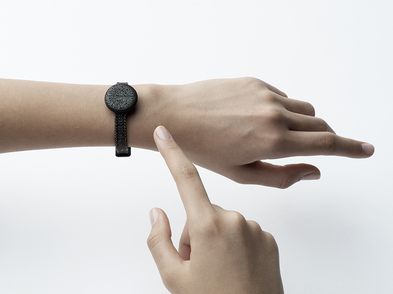 The Trove security device pictured on a model's wrist