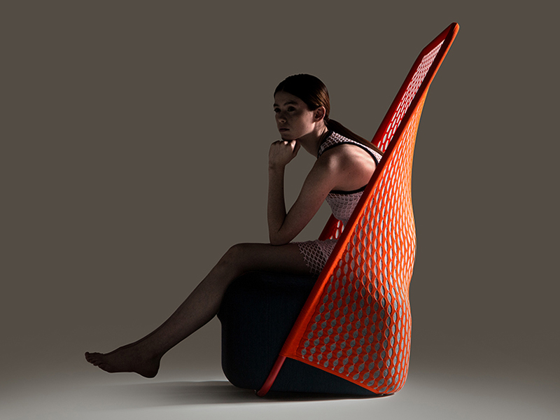 A model sits in the Cradle chair for furniture brand Moroso