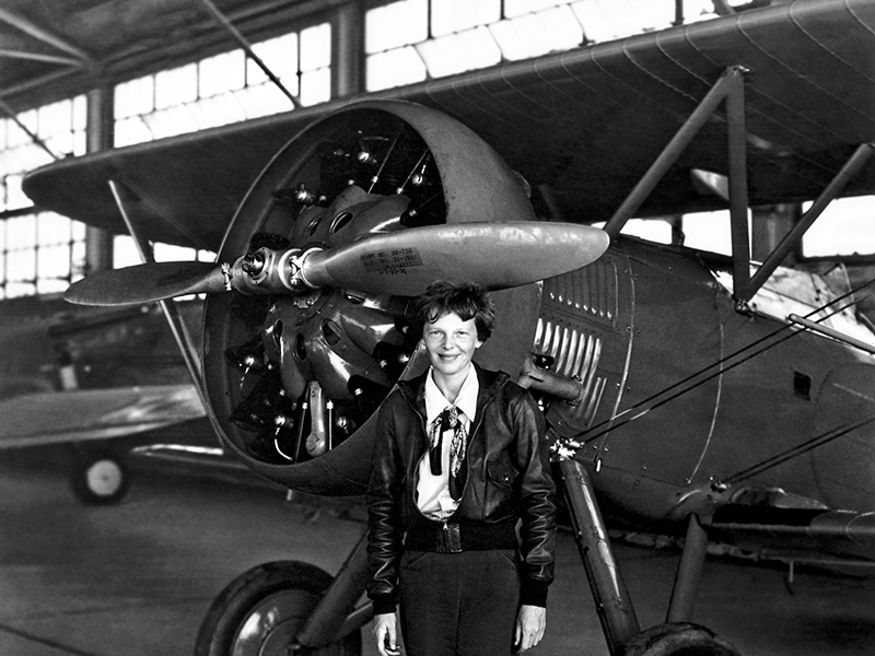Aviation pioneer Amelia Earhart poses with her airplane in a hangar July 30, 1936. Earhart was the first female aviator to fly solo across the Atlantic Ocean