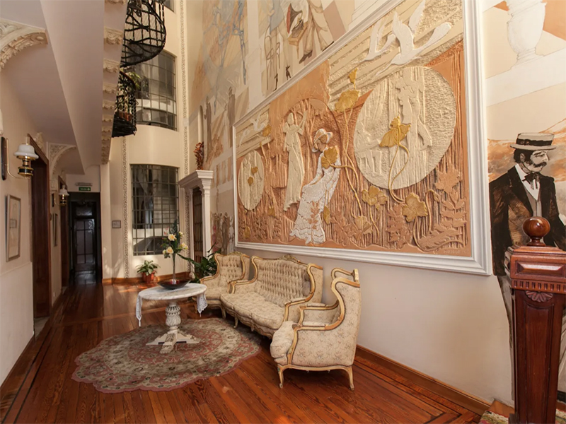 The hallway, featuring a fresco painting, of an Argentinian mansion