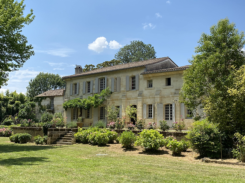 A grand limestone chateau with landscaped gardens